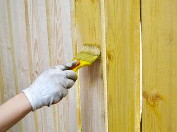 Painting a wood fence