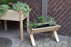 DIY Friendly Cedar Wedge Garden Planter for herbs and small plants