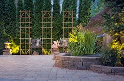 Tall wooden ladder trellis adds dimension and style to outdoor patio