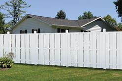 Bloomington Shadowbox vinyl fence along backyard property line