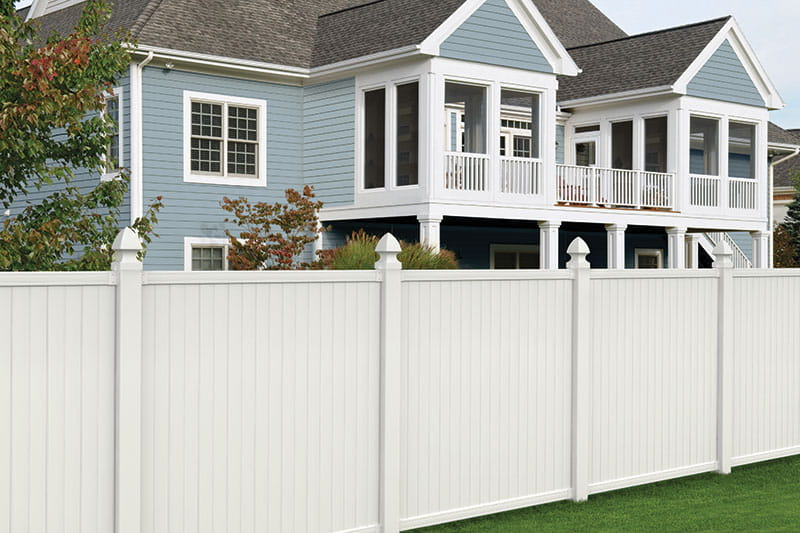 Outdoor Essentials Olympia Privacy Vinyl Fence along backyard