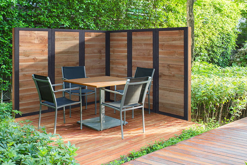 Build a deck privacy screen or create patio privacy with Outdoor Essentials 2x6 wood fence panels.