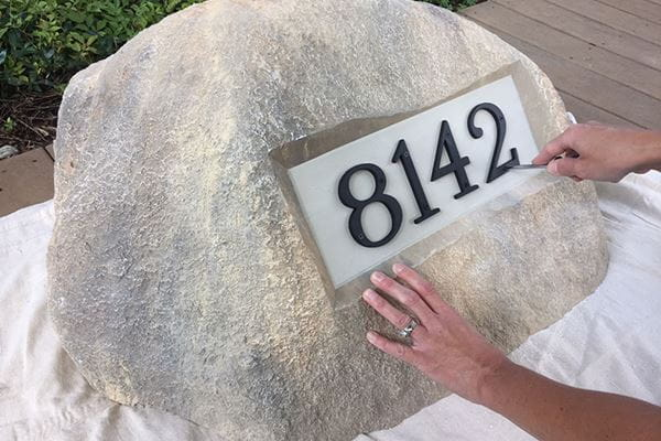 Adding house number to personalized artificial address rock