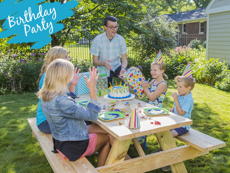 Outdoor Essentials wood picnic table with outdoor birthday party