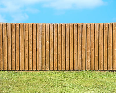 Pressure Treated board on board fence with rot board