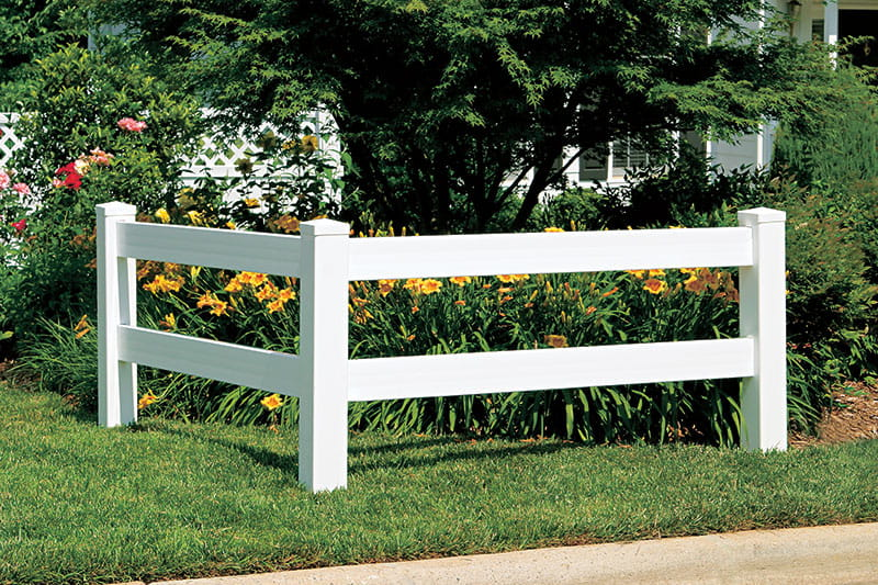 White 2 rail viny ranch rail fence corner used as landscape accent