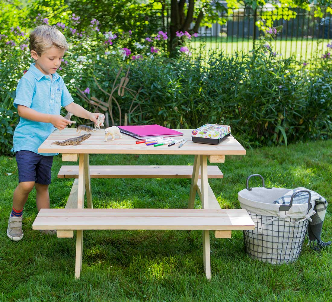 outdoor essentials picnic table with boy playing
